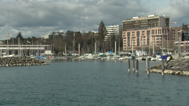 shows exterior shots boats in marina and people walking along lakeside in lausanne on lac leman . the international olympic committee says the summer... - lake stock videos & royalty-free footage