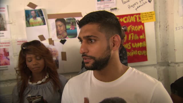 shows exterior shots boxer amir khan speech soundbite speaking on supporting survivors, raising money. locals and volunteers have claimed that... - co ordination stock videos & royalty-free footage
