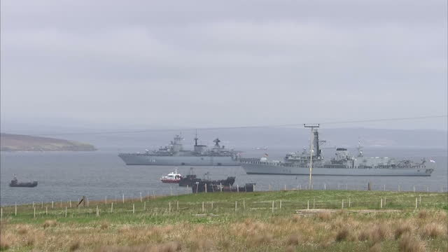 shows exterior shots british navy ship hms kent and german naval ship sms schleswig-holstein moored in scapa flow with zoom out to show lyness world... - hoy stock videos & royalty-free footage