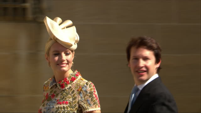 Shows exterior shots British singer James Blunt and Sofia Wellesley arriving at St George's Chapel for the wedding of Prince Harry Duke of Sussex and...