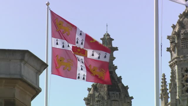 shows exterior shots cambridge university flag and trinity hall flag flying in wind on sunny day. the met office says the uk has recorded one of its... - cambridge university stock videos & royalty-free footage