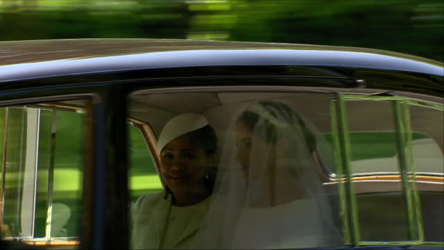 shows exterior shots car carrying meghan markle and her mother doria ragland departing cliveden hotel on way to windsor for the wedding of prince... - königliche hochzeit stock-videos und b-roll-filmmaterial