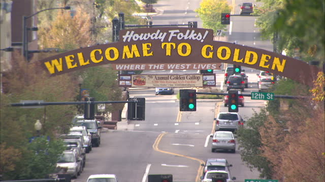 shows exterior shots cars driving through golden with hillside in the background on october 03 2012 in colorado co - california gold rush stock videos and b-roll footage