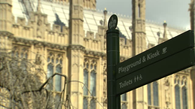 shows exterior shots carvings on exterior of houses of parliament lamps around outside and gilded roff being lit by the sun on the houses of... - gilded stock videos & royalty-free footage