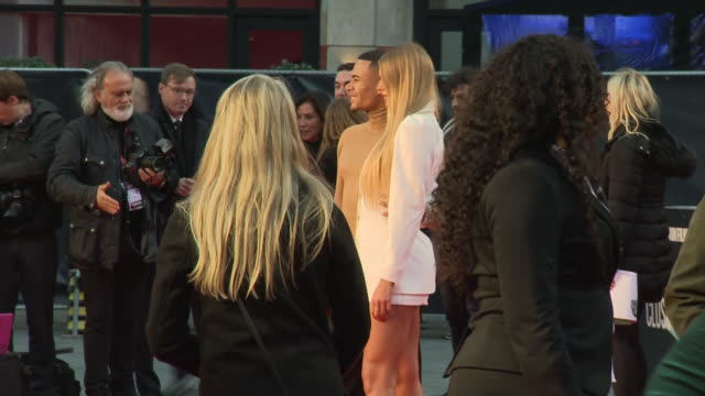 shows exterior shots celebrities wes nelson and arabella chi on the red carpet for the bfi's london film festival closing night gala premiere of... - premiere stock-videos und b-roll-filmmaterial