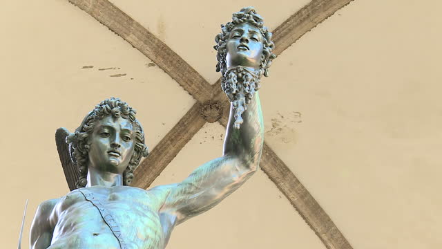 shows exterior shots cellini's statue of perseus slaying medusa under loggia dei lanzi on 22nd september 2017 in florence italy - florence italy stock videos and b-roll footage