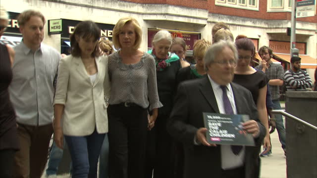shows exterior shots charity workers, campaigners and celebrities including juliet stevenson and samuel west delivering petition calling for britain... - juliet stevenson stock videos & royalty-free footage