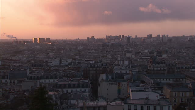 shows exterior shots city of paris skyline with the sun setting and zoom into factory on the horizon on january 11 2015 in paris france - basilique du sacre coeur montmartre stock videos & royalty-free footage