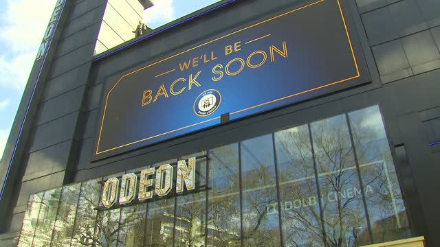 shows exterior shots closed cinemas in london's leicester square on day before shops reopen due to pandemic restrictions in central london on a sunny... - film industry stock videos & royalty-free footage