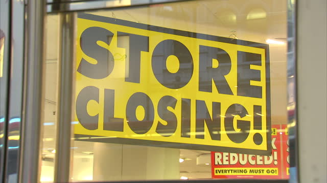 shows exterior shots closed down bhs store near closed down woolworths store. exterior and interior shots posters and signs offering discounts in... - door chain stock videos & royalty-free footage