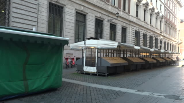 shows exterior shots closed market stalls in one of the tourist hotspot streets in central rome europe's worst affected country italy has entered its... - tourist stock videos & royalty-free footage