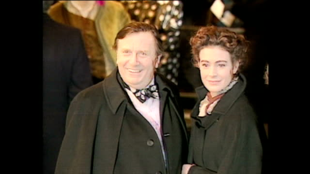 shows exterior shots comedian barry humphries and actress sean young arriving and posing for photographs at the royal premiere of the film 'hook' on... - 1992 stock videos and b-roll footage