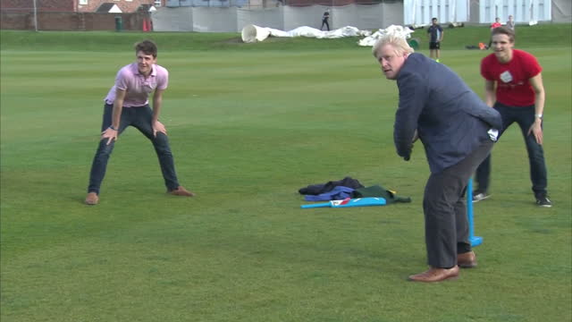 shows exterior shots conservative mp and 'out' campaigner boris johnson standing with 'out' supporter and former england cricketer ian botham having... - 2016 european union referendum stock videos and b-roll footage