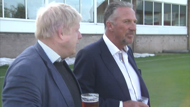 shows exterior shots conservative mp and 'out' campaigner boris johnson with 'out' supporter and former england cricketer ian botham walking out of... - 2016 european union referendum stock videos and b-roll footage