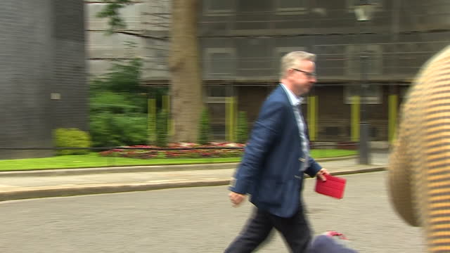 shows exterior shots conservative mp michael gove departing from downing street the diminished power of theresa may within her own party was made... - michael gove stock-videos und b-roll-filmmaterial