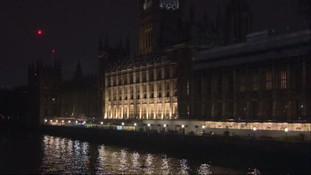 shows exterior shots conservative party mps having party in the terrace bar of the house of parliament and lights reflecte in river thames at night... - electric lamp stock videos & royalty-free footage