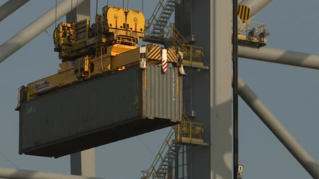 shows exterior shots containers being lifted by cranes at london gateway port and placed onto container ships, on 1st april, 2019 in london, england,... - crane stock videos & royalty-free footage