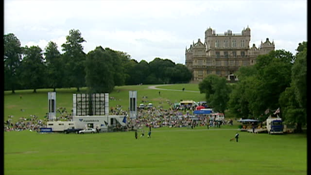 shows exterior shots cricket fans watching the ashes on a big screen in the grounds of wollaton hall on august 27 2005 in nottingham england - cenere video stock e b–roll