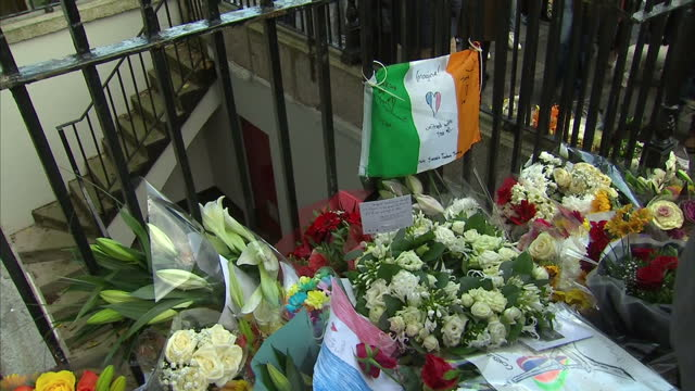 Shows Exterior shots crowd of people gathered outside the French Embassy in Dublin and flowers laid in memory of victims of Paris Terror attacks...