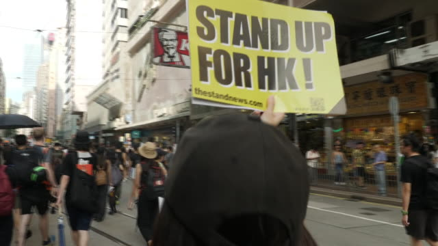 shows exterior shots crowd of protesters filling street marching along chanting in hong kong the day began peacefully as they chanted 'free hong... - chanting stock videos and b-roll footage