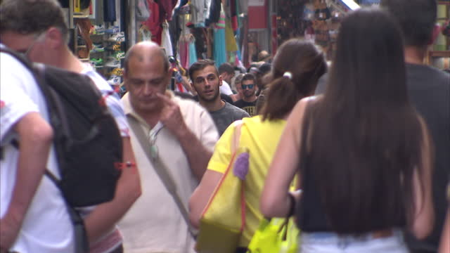 shows exterior shots crowds of people walking through shopping district in athens on june 28 2015 in athens greece - panathinaiko stadium stock videos & royalty-free footage