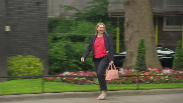 Shows exterior shots Culture Media and Sport Secretary Karen Bradley walking to 10 Downing Street Theresa May's new Cabinet is meeting for the first...