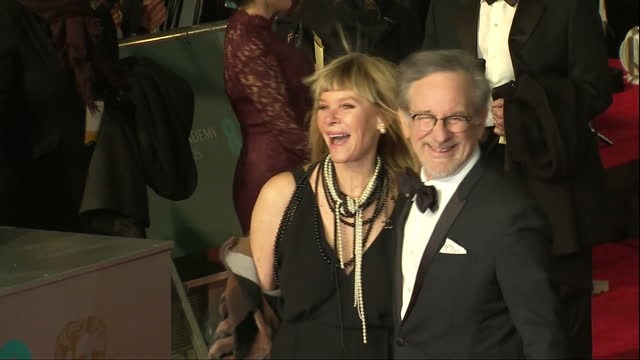 Shows Exterior shots Director Steven Spielberg and his wife actress Kate Capshaw posing for photos on red carpet The 2016 BAFTAS Film Awards ceremony...