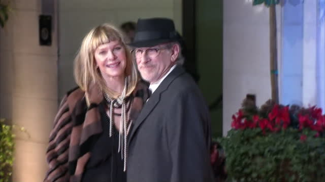 Shows Exterior shots director Steven Spielberg and his wife Kate Capshaw on red carpet arriving at Grosvenor House Hotel for BAFTA Awards after party...