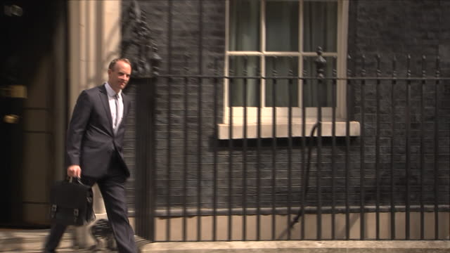 stockvideo's en b-roll-footage met shows exterior shots dominic raab mp leaving number 10 downing street, as he is appointed the new brexit secretary. brexit secretary david davis has... - number 9