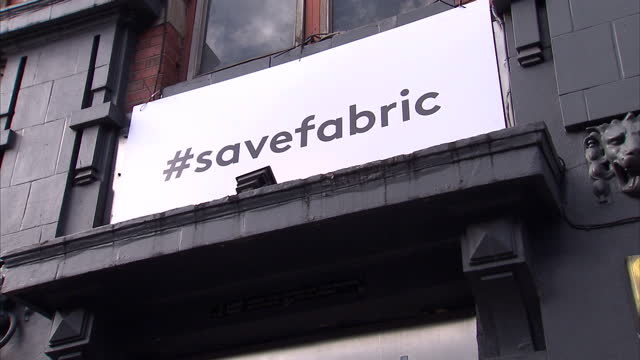 """shows exterior shots doors into fabric nightclub with people leaving flowers, messages and signs reading """"rip fabric"""" and """"#savefabric"""". exterior... - dance music stock videos & royalty-free footage"""