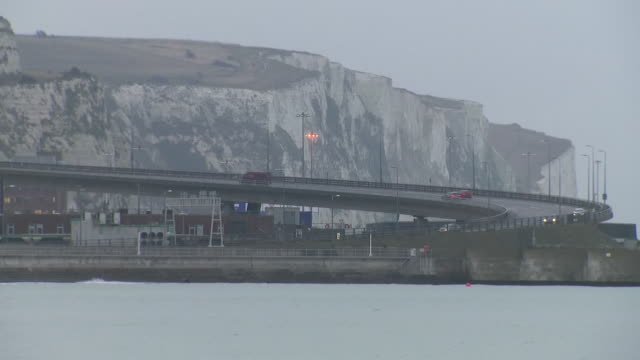 shows exterior shots dover port traffic driving across flyover arriving and leaving on 17th december 2019 in dover kent england united kingdom - motorway junction stock videos & royalty-free footage