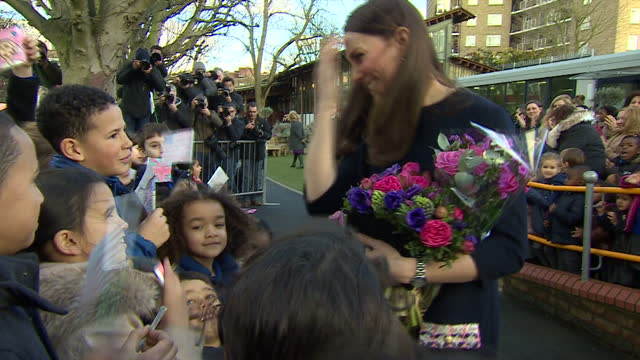 Shows exterior shots Duchess of Cambridge walking through school playground with flowers saying goodbye to the schoolchildren on January 15 2015 in...