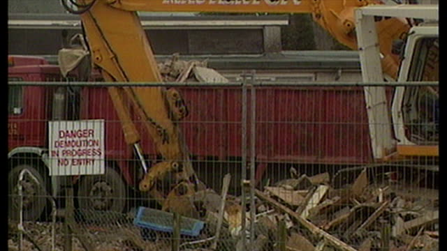 shows exterior shots dunblane school gym being demolished with digger putting wreckage into back of a truck with police tape cordoning off the area... - dunblane school massacre stock videos & royalty-free footage