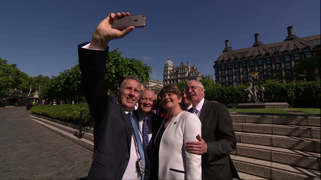 Shows exterior shots DUP MPs taking selfies with DUP Leader Arlene Foster outside the Houses of Parliament and saying 'the future's bright' 'the...