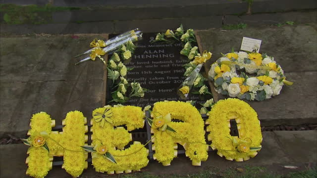 shows exterior shots eccles high street with yellow ribbons and memorial to alan henning british aid worker who was killedby jihadi john interviews... - executioner stock videos & royalty-free footage
