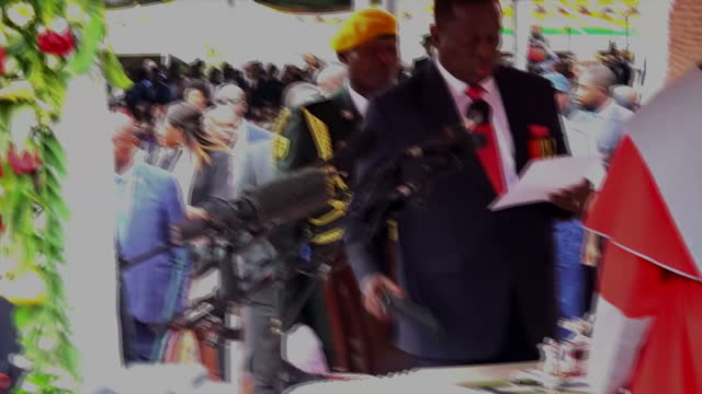 shows exterior shots ecstatic crowds filling stadium and emmerson mnangagwa arriving and being sworn in as the new president of zimabwe the people of... - harare stock videos and b-roll footage