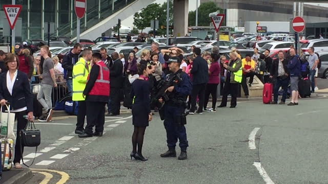 shows exterior shots emergency services including armed police officers outside manchester airport following a bomb scare on 5th july, 2017 in... - evakuierung stock-videos und b-roll-filmmaterial