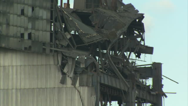 shows exterior shots end of the still standing part of the collapsed building with twisted metal and wreckage where collapse happened at didcot power... - didcot stock videos and b-roll footage