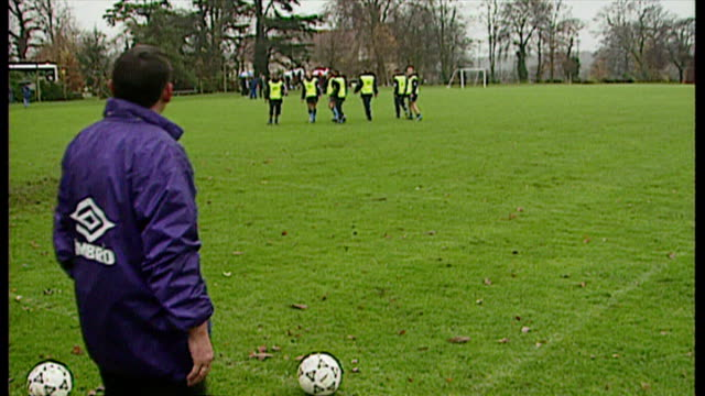 shows exterior shots england football manager graham taylor kicking footballs to players during training session at bisham abbey on november 13th... - major league soccer stock videos and b-roll footage