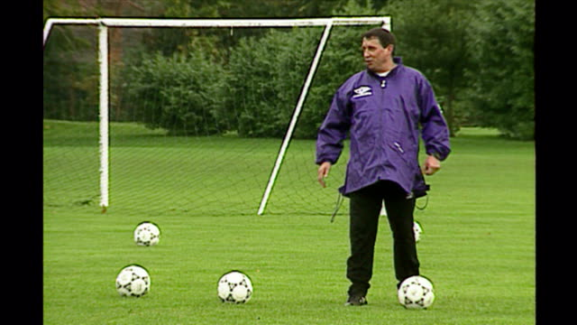 shows exterior shots england football manager graham taylor laughing as he kicks ball during england team training session on october 9th 1993 in... - fußballweltmeisterschaft 2010 stock-videos und b-roll-filmmaterial