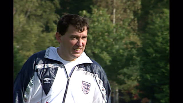 shows exterior shots england football manager graham taylore kicking football around during training session on october 12th 1990in london england - major league soccer stock videos and b-roll footage
