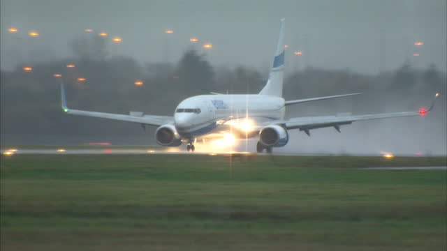 Shows Exterior shots Enter Air plane landing at Glasgow Airport carrying first 100 Syrian refugees to be resettled in the UK A charter flight...