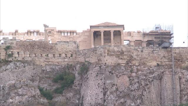 shows exterior shots erechtheion temple atop the acropolis from the monastiraki flea market on june 28 2015 in athens greece - the erechtheion stock videos & royalty-free footage