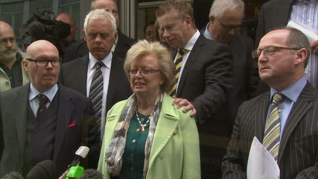 shows exterior shots families of victims of 1974 birmingham pub bombings leaving court following judges decision soundbite from julie hambleton... - west midlands stock-videos und b-roll-filmmaterial