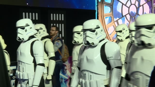 shows exterior shots fans and people in costumes from the star wars films walk up the red carpet and stand behind barriers waiting for stars to... - star wars stock videos & royalty-free footage