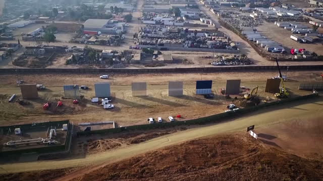 shows exterior shots fences along border between usa and mexico near san diego exterior shots including aerial shots prototype walls built by eight... - undocumented immigrant stock videos & royalty-free footage