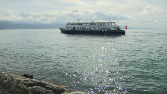 shows exterior shots ferry departing from lausanne as it travels on lac leman . the international olympic committee says the summer games in tokyo... - lake stock videos & royalty-free footage