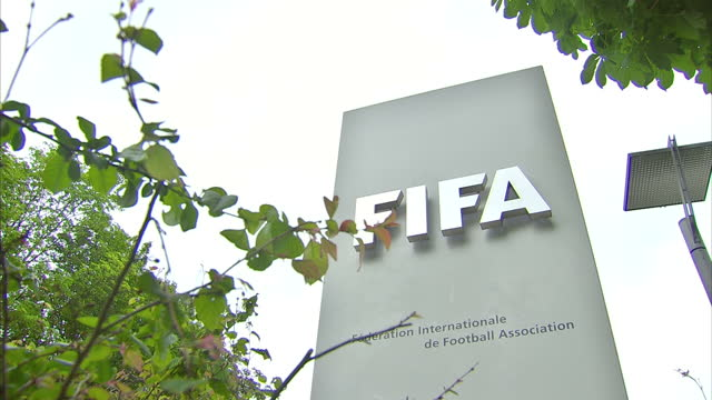 shows exterior shots fifa sign at entrance to the headquarters wooden fifa centennial statue for world football on may 29 2015 in zurich switzerland - fifa stock videos & royalty-free footage