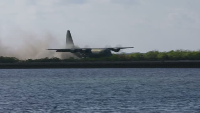 shows exterior shots filipino military plane landing on pagasa island in south china sea president obama today ended america's arms embargo on... - south china sea stock videos & royalty-free footage