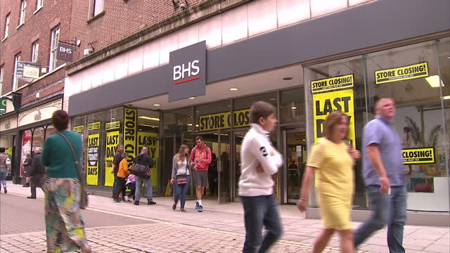 shows exterior shots final day of york's bhs store opening, with customers walking in and out and large 'store closing' and 'last day today' posters... - last day stock videos & royalty-free footage